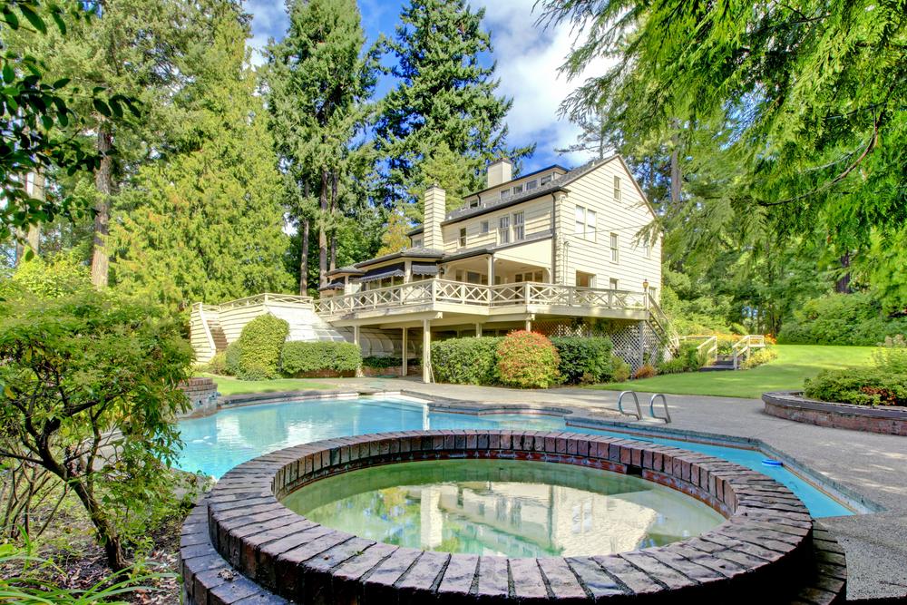 Backyard oasis pool with hot tub