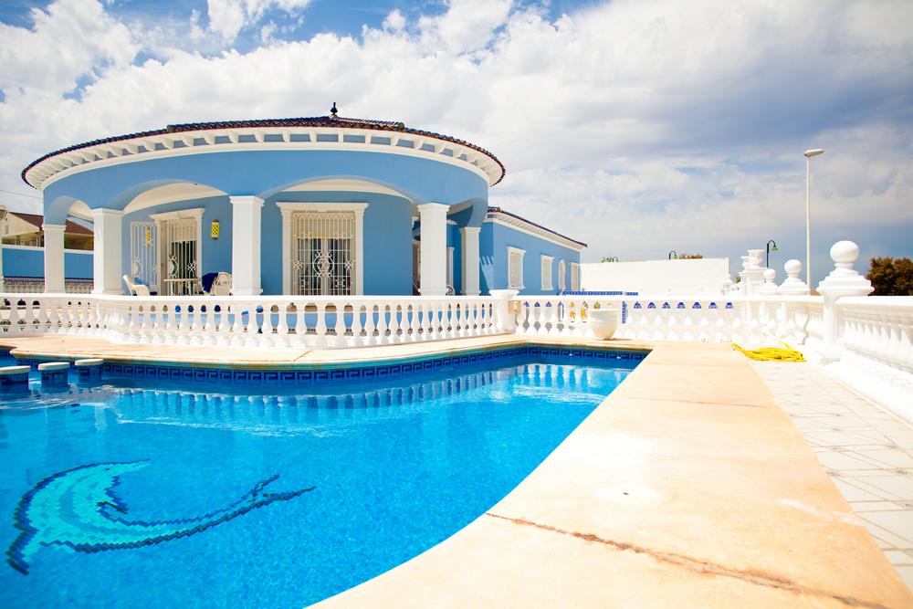 Beach house pool with dolphin
