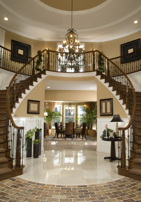 Glamorous entry way with double stairs