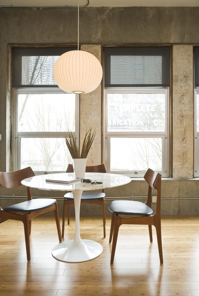 Globe light over wood floor