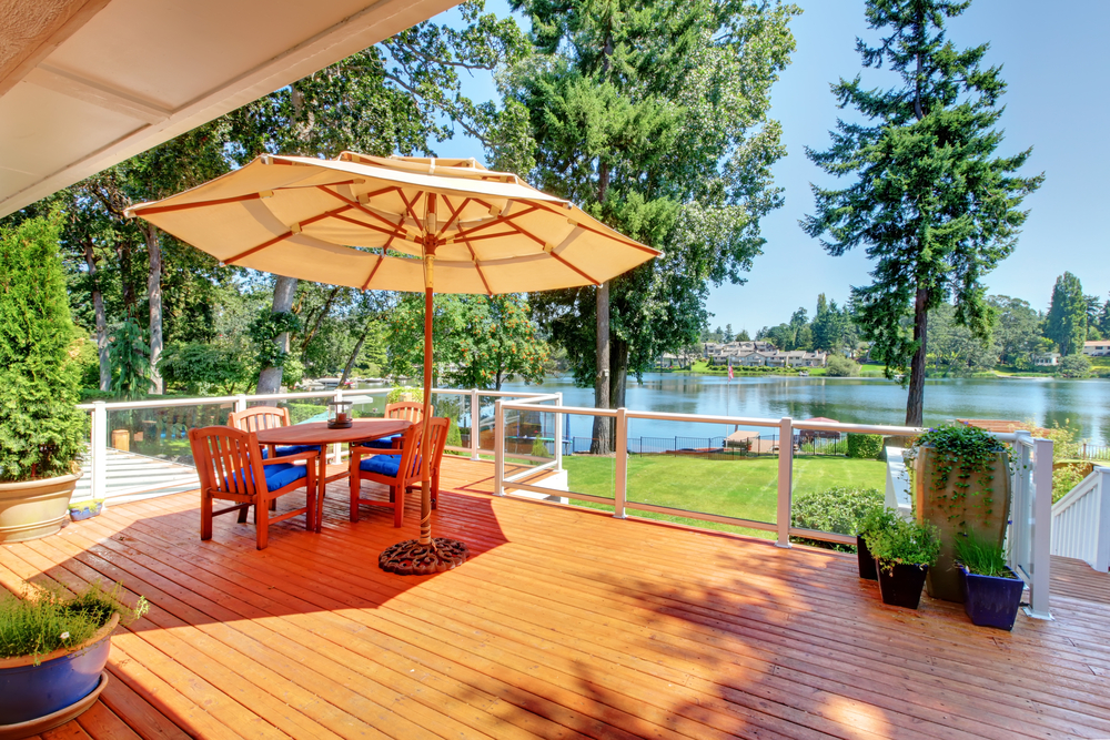 Lake patio design ideas with cabana