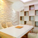 Luxurious dining room table with white chairs