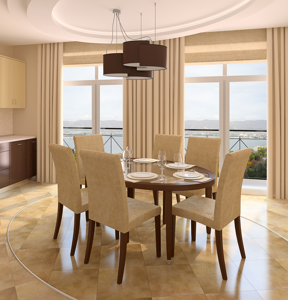 Marble dining room floor with beige chairs and wood table
