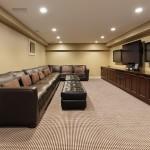 Nodern basement with 3 TVs