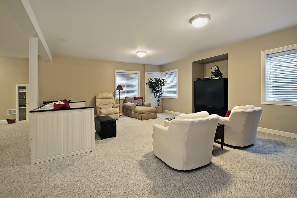 Modern basement with beige accents