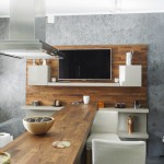 Modern kitchen with wood countertops and TV