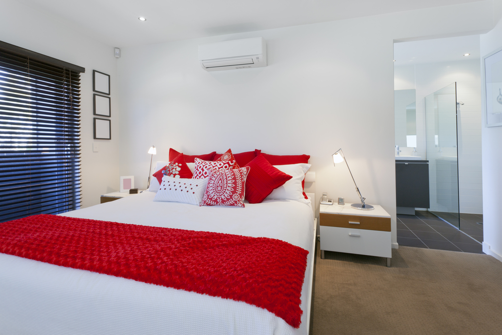 Modern master bedroom with red accents