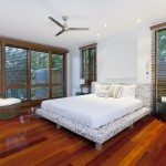 Modern master bedroom with wood floors