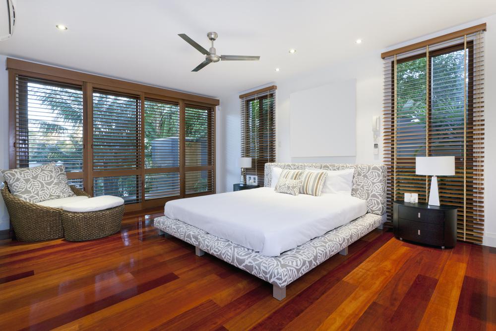 Modern master bedroom with wood floors