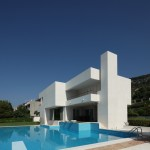 Modern square pool and house