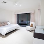 Spacious master bedroom with white accents