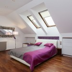 Stylish attic bedroom with wood floor