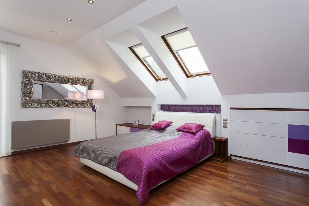 Stylish attic bedroom with wood floor