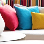 White couch sofa colorful pillows