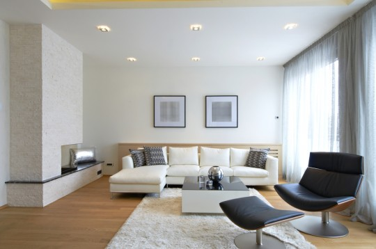 simple white living room with bare essentials