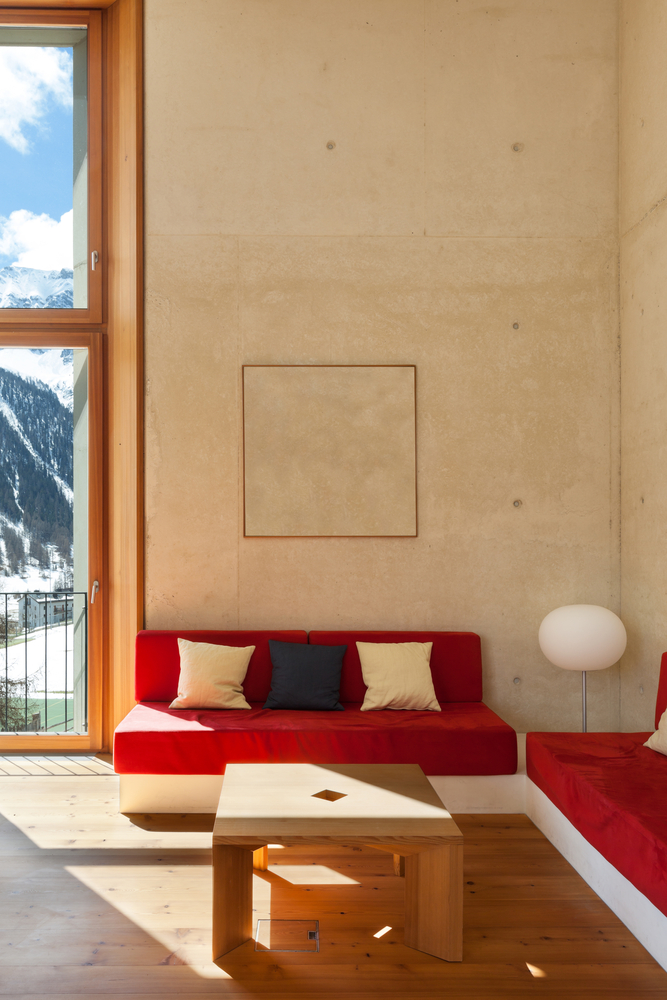 Small living room with red couch