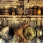 Displaying various spices and frying pans is a great way to add style to your rustic kitchen.